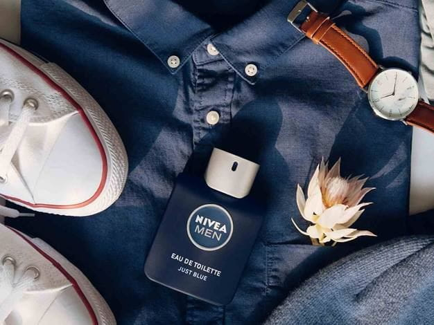 NIVEA MEN Eau de Toilette on a blue tshirt
